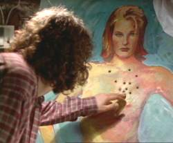 Jonathan looks at the bullet holes in the painting of Francesca